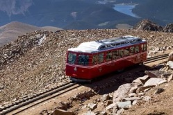 62352044-pikes-peak-cog-railway-car-leaving-the-top-of-pikes-peak-mountain-top-in-colorado-on-sunny-summer-mo